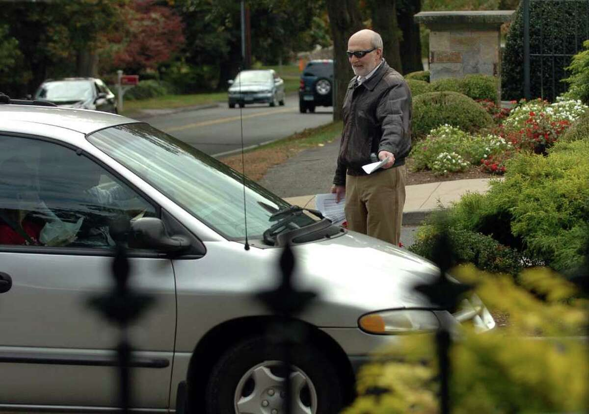 Child abuse advocate Bob Sidorowicz, of Quincy MA, hands out flyers durng a protest held at the main gate at Fairfield University on Saturday October 23, 2010. The demonstration was over the school's refusal to pay for the schooling for children caught up in the scandal involving Project Pierre Toussaint's former director, Douglas Perlitz.