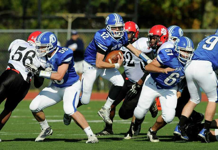 Darien quarterback Chris Allam finds some real estate as Darien High School hosts Red Lion Christian Academy in Darien, CT on Saturday, October 23, 2010. Photo: Shelley Cryan / Shelley Cryan freelance; Stamford Advocate Freelance