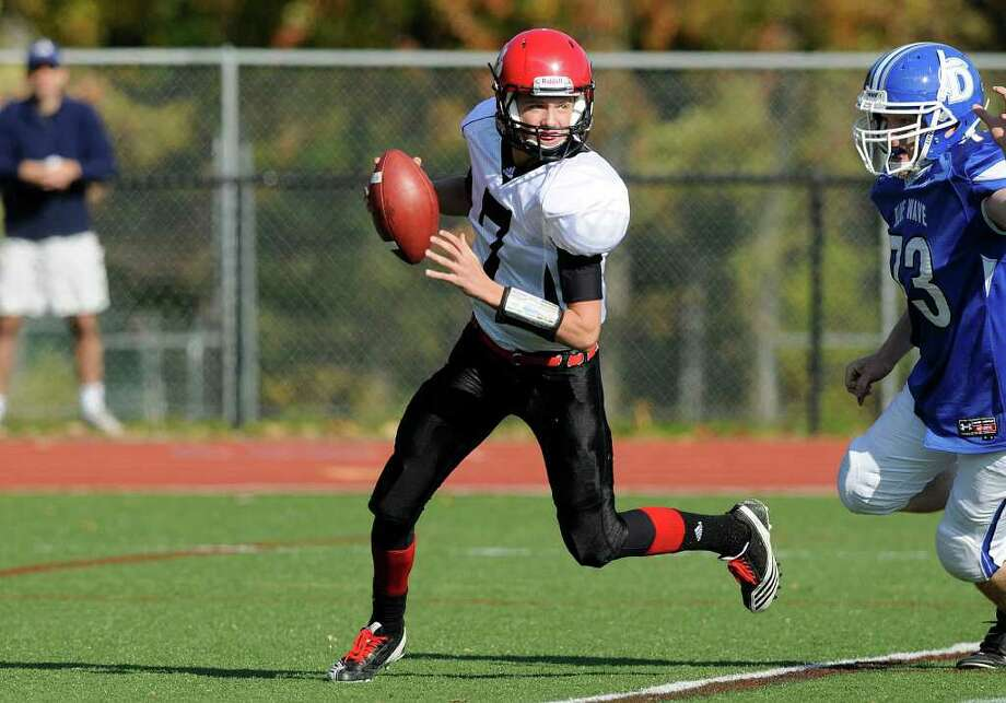 Red Lion quarterback David Sills goes back for a pass as Darien High School hosts Red Lion Christian Academy in Darien, CT on Saturday, October 23, 2010. Photo: Shelley Cryan / Shelley Cryan freelance; Stamford Advocate Freelance