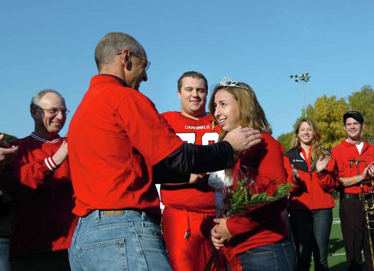 Alex DiStefano is crowned homecoming queen during halftime of the Greenwich High School vs. Bridgeport Central High School football game at Greenwich High School, Saturday afternoon, Oct. 23, 2010. In the background center is GHS senior football Jeff Wilson, who was crowned king. At far left is Greenwich Superintendent of Schools Sidney Freund.