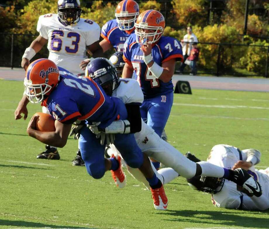 Westhill high school at Danbury High school varsity football game Sat. Oct. 23, 2010. Westhill's Kieran Bowman, tackles Danbury's Deyon Rosato. Photo: Lisa Weir / The News-Times Freelance