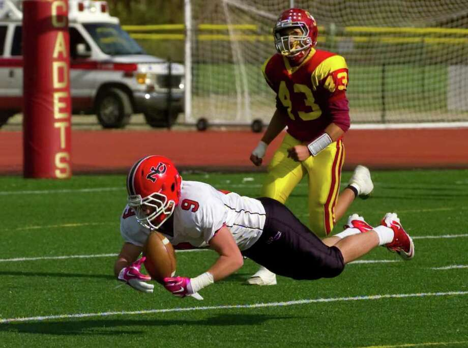 New Canaan's #9 Jimmy Joe Granito goes to the ground while trying to catch a pass to him, during football action against St. Joseph's in Trumbull, Conn. on Saturday October 23, 2010. The pass was incomplete. Photo: Christian Abraham / Connecticut Post