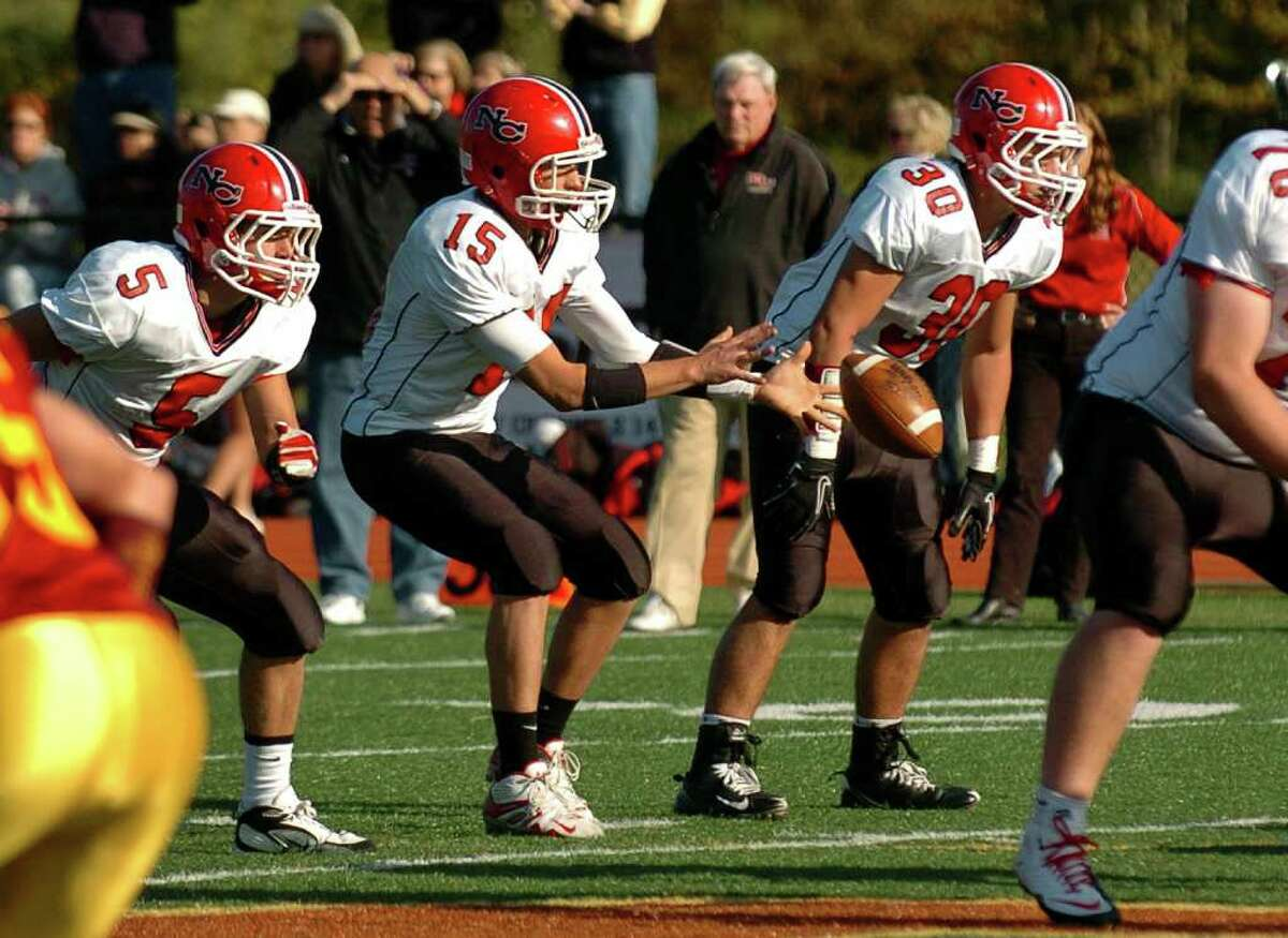 New Canaan QB Jake Granito receives the snap, during football action against St. Joseph's in Trumbull, Conn. on Saturday October 23, 2010.