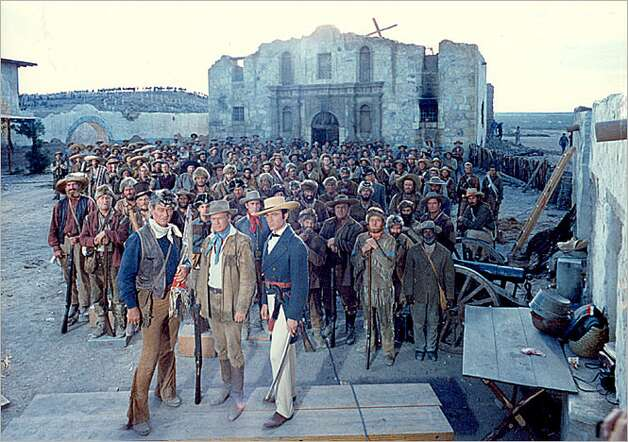 The Alamo defeners from the 1960 film, including (front row, from left) John Wayne as Davy Crockett, Richard Widmark as Jim Bowie and Laurence Harvey as William Travis.