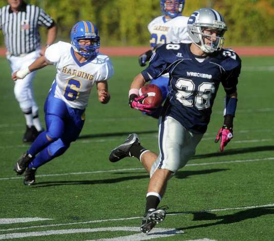 John Heil carries the ball to a ten-yard touchdown during Saturday's game against Harding High School in Westport on October 23, 2010. Photo: Lindsay Niegelberg / Connecticut Post
