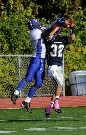 Staples' Greg Strauss intercepts the ball during Saturday's game against Harding High School in Westport on October 23, 2010. Photo: Lindsay Niegelberg / Connecticut Post