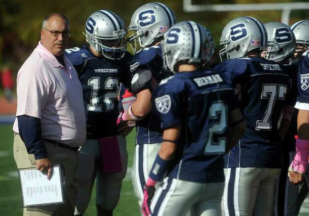 Staples coach Marce Petroccio talks to his team during Saturday's game against Harding High School in Westport on October 23, 2010. Photo: Lindsay Niegelberg / Connecticut Post