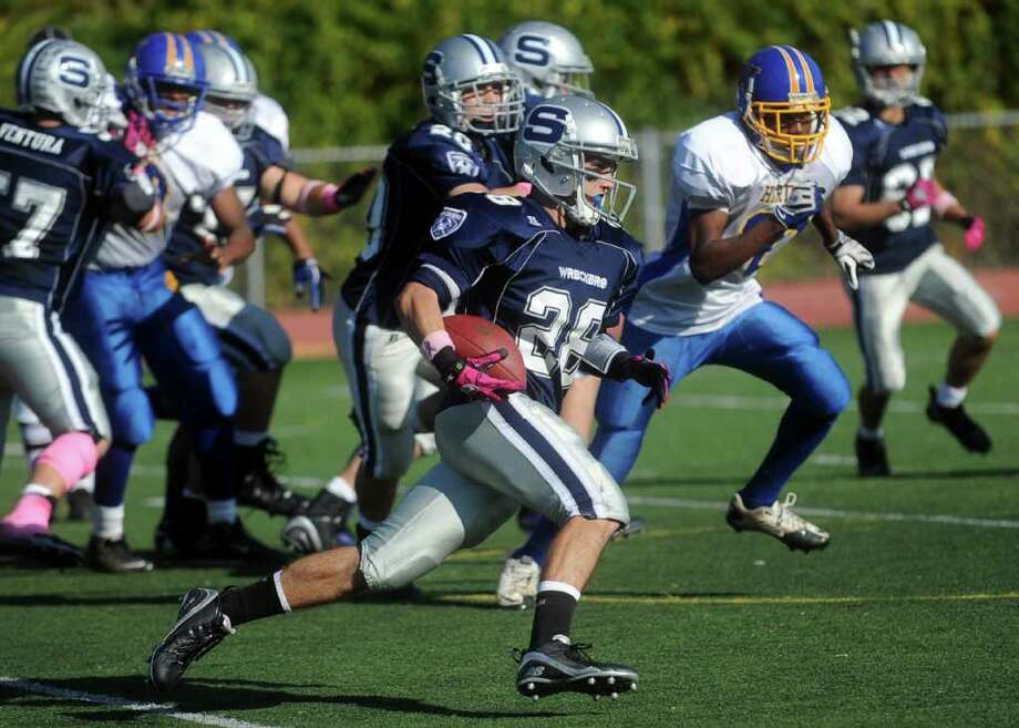Staples' John Heil carries the ball during Saturday's game against Harding High School in Westport on October 23, 2010. Photo: Lindsay Niegelberg / Connecticut Post
