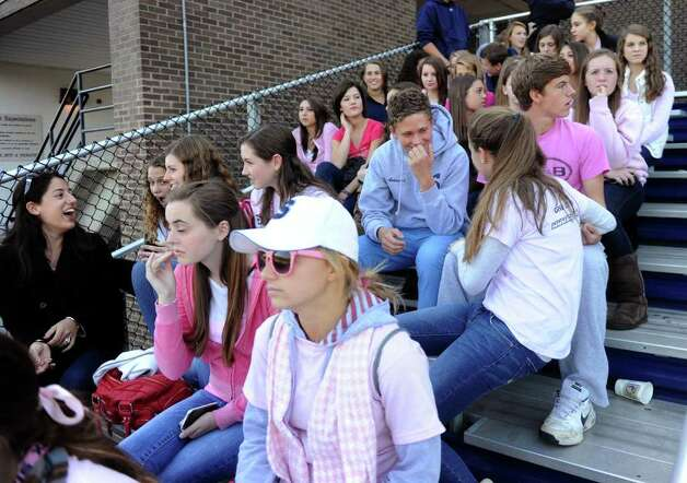 Members of the audience wear pink to support breast cancer awareness during Saturday's game at Staples against Harding High School in Westport on October 23, 2010. Photo: Lindsay Niegelberg / Connecticut Post