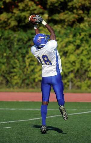 Harding's Antione Clarke makes a catch during Saturday's game against Staples High School in Westport on October 23, 2010. Photo: Lindsay Niegelberg / Connecticut Post