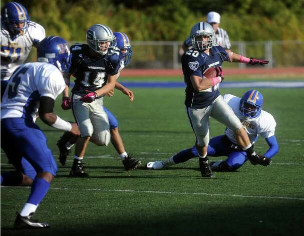 Staples' Robbie Wolf carries the ball for a five-yard gain during Saturday's game against Harding High School in Westport on October 23, 2010. Photo: Lindsay Niegelberg / Connecticut Post