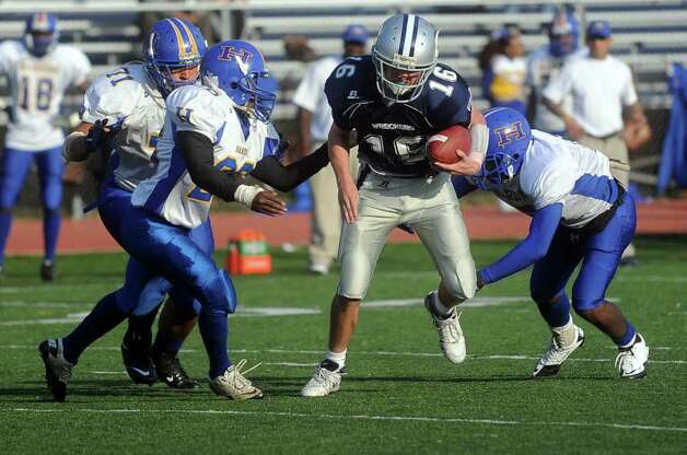 Jack Massie carries the ball for Staples during Saturday's game against Harding High School in Westport on October 23, 2010. Photo: Lindsay Niegelberg / Connecticut Post
