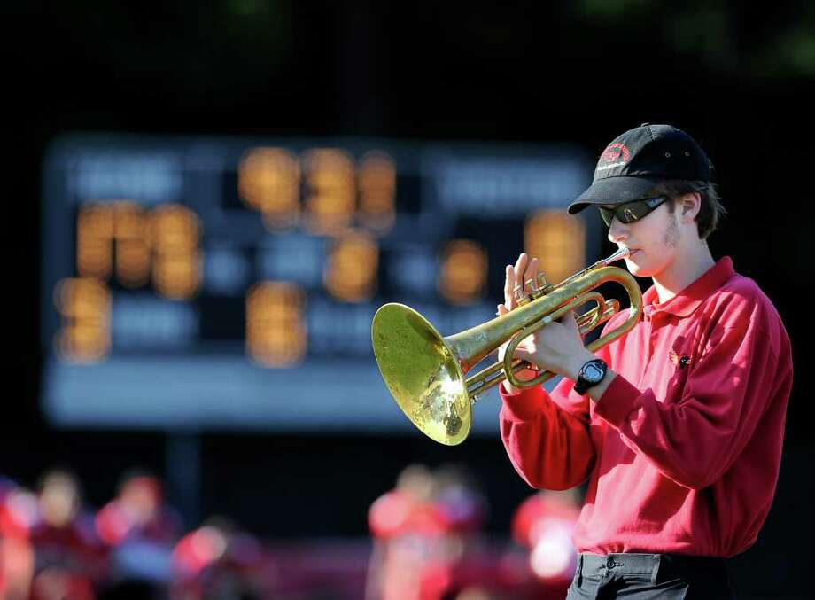 A member of the GHS band during halftime of the Greenwich High School football vs. Bridgeport Central High School football game, at Greenwich High School, Saturday afternoon, Oct. 23, 2010. Photo: Bob Luckey / Greenwich Time