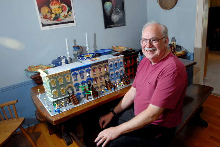 Bill Leue, who recreated Upper Elm Street from Legos, shows the final result in 2009. His next project may be a State Street home designed by architect H.H. Richardson. (Cindy Schultz / Times Union