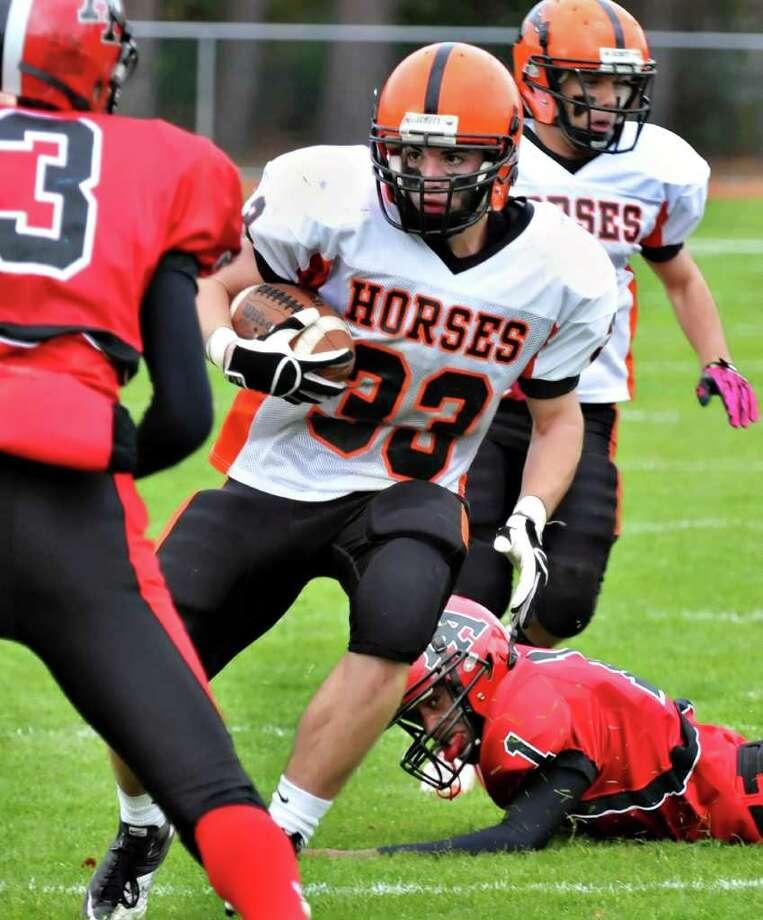 High school football -- Schuylerville's Steve Booth (33) runs the ball against Albany Academy. (John Carl D'Annibale / Times Union) Photo: John Carl D'Annibale / 00010744A