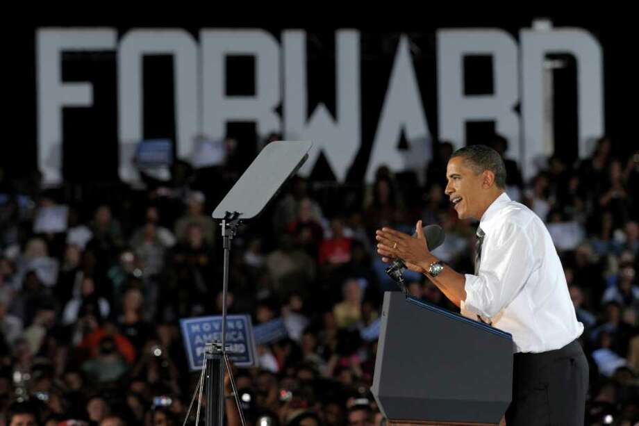 President Barack Obama is defending financial reforms approved by the Democratic Congress. He speaks at a rally for Senate Majority Leader Harry Reid, D-Nev., at Orr Middle School in Las Vegas, Friday..  (AP Photo/Susan Walsh) Photo: Susan Walsh