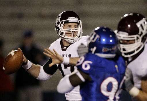 Texas A&M quarterback Ryan Tannehill (17) plays against Kansas on Saturday. Tannehill was 12 of 16 with three touchdown passes and a rushing touchdown in the 45-10 victory.