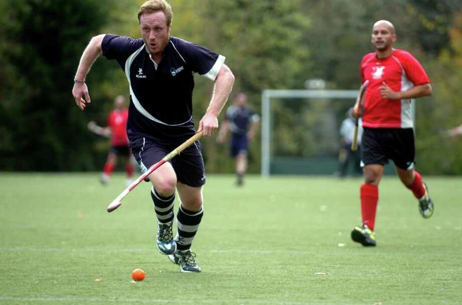 Travis Starr, of England at the field hockey exhibition at Greenwich Academy on Sunday, Oct. 24, 2010. The teams that make up the New England Field Hockey Association draw players from around the tri-state area and compete in the fall and spring at Columbia University in Manhattan. Photo: Helen Neafsey / Greenwich Time