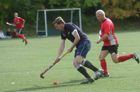 No skirts required: Men play field hockey match in Greenwich