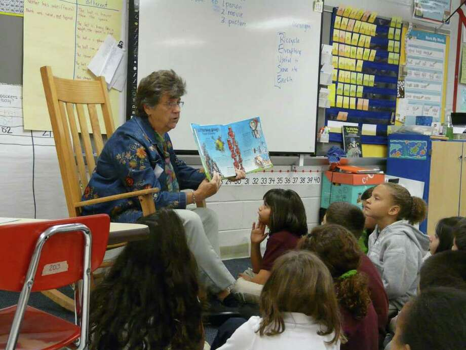 Fairfield resident Dorothy Daruka reads to Cathy McElroy's second grade class at the Six to Six school. Photo: Contributed Photo / Fairfield Citizen contributed
