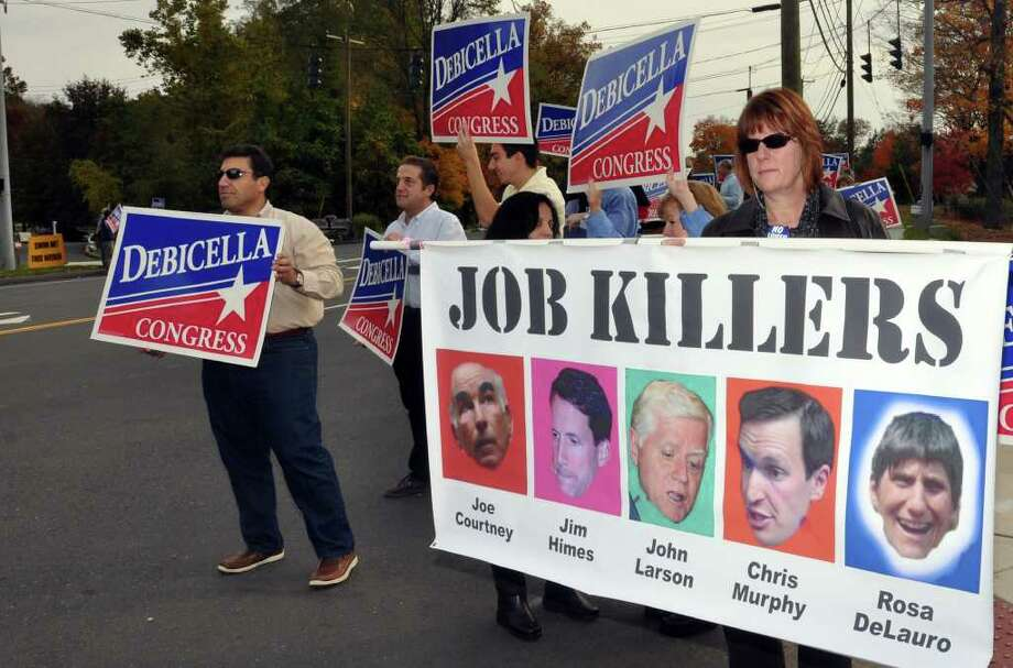 """Kathy Doornbosch, of Trumbull, a supporter of Dan Debicella, holds up a sign titled """"Job Killers"""" in reference to candidates Joe Courtney, Jim Himes, John Larson, Chris Murphy and Rosa DeLauro before the 4th Congressional District Candidates' Debate sponsored by the League of Women Voters at Wilton High School on Sunday, Oct. 24, 2010. Photo: Amy Mortensen / Connecticut Post Freelance"""