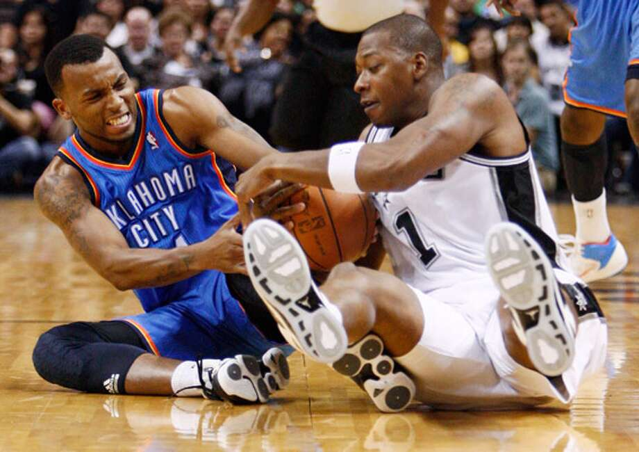 Bobby Simmons of the Spurs (right), battling for the ball with Oklahoma City's Daequan Cook last Monday, apparently will be on the team to start the season.
