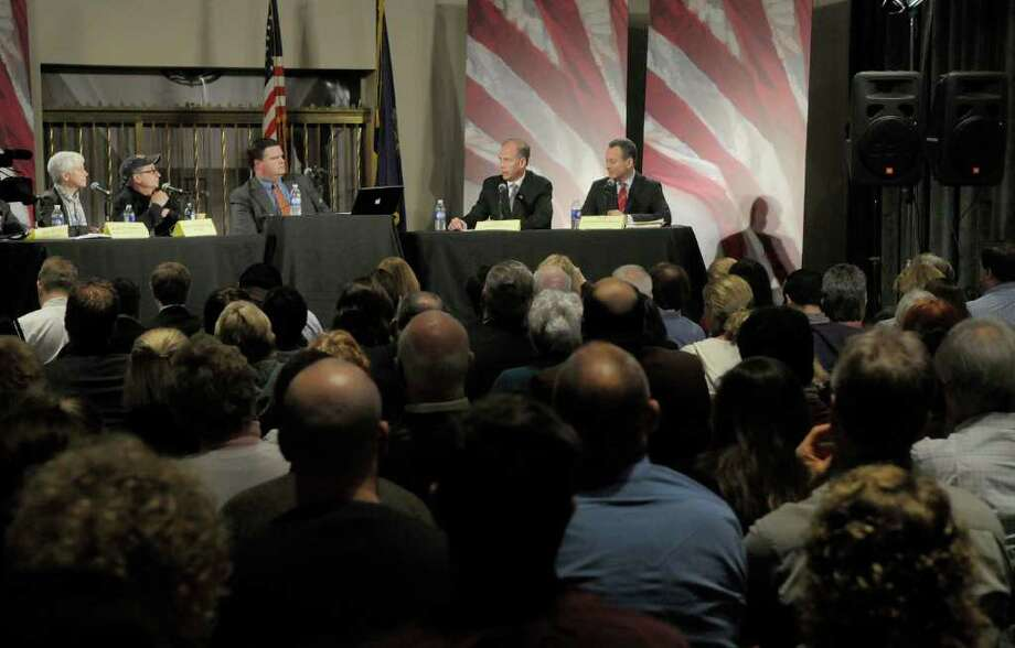 State attorney general candidates Dan Donovan, second from right, and Eric Schneiderman, far right, take part in a debate Monday at the WAMC Linda Norris Auditorium in Albany. (Paul Buckowski / Times Union) Photo: Paul Buckowski