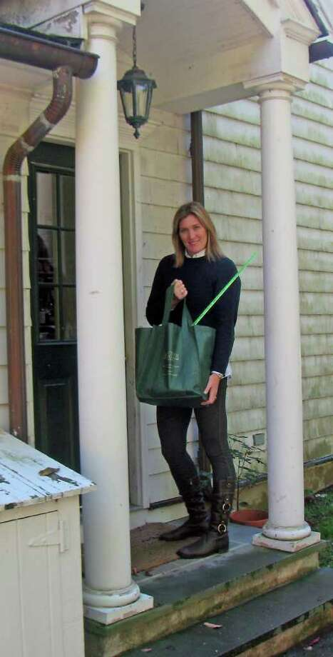 Stephanie Radman of New Canaan  this spring bought The Town Greeter, which presents gift baskets full of products from local businesses to people who have just moved into their towns. Photo: Contributed Photo / Stamford Advocate Contributed