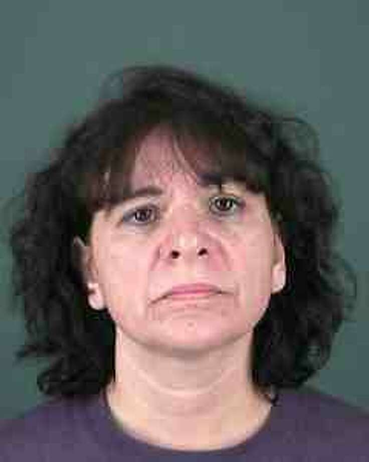 Deanna Morello, 49, of Rensselaer, was charged with criminal contempt and trespass after allegedly throwing a brick through a window at her husband's Albany home on Sunday, Oct. 24, 2010. (Courtesy: Albany Police Department)