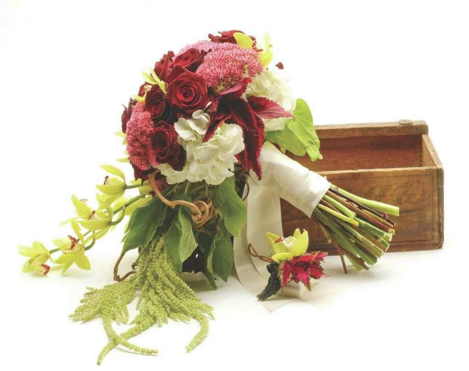 (Will Waldron/VOW) DETAILS: Splendid Stems, Karen Splendido SplendidStems.com 518-280-5412  BOUQUET: Black baccara roses, white hydrangea, mini cymbidium orchids, hanging amaranths, kiwi vine, and from Splendido?s garden, sedum, coleus, and sweet potato vines.  BOUTONNIERE: Mini cymbidium orchid, inky fingers coleus, Queen Anne?s lace, and kiwi vine.