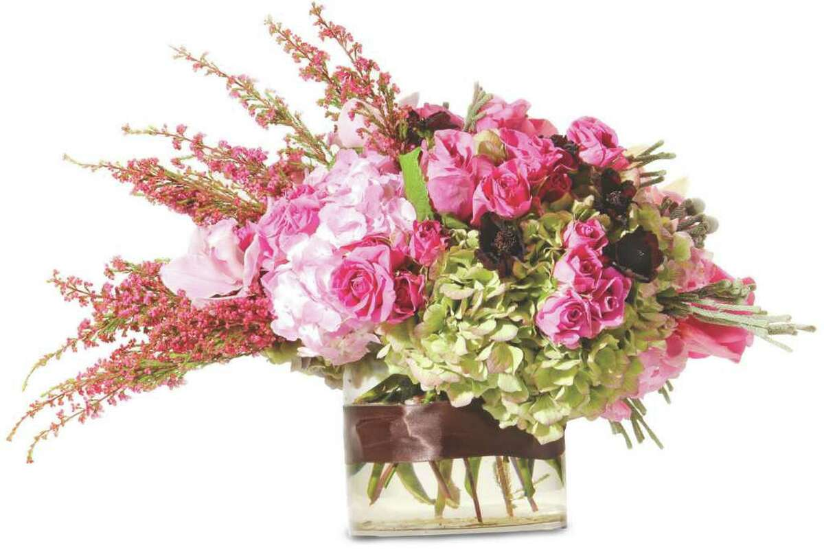 (Will Waldron/VOW) DETAILS: Price Chopper Central Market Florist Margette Jobin, Floral manager 518-383-6785 ARRANGEMENT INCLUDES: Antique green hydrangea, natural pink hydrangea, pink garden roses, cymbidum orchids, chocolate cosmos, heather, and silver brunia.