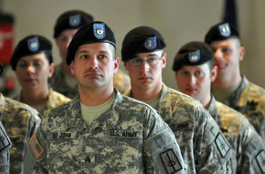 Sgt. William St. John of Queensbury stands at attention during a mobilization farewell ceremony for the Headquarters, 501st Ordnance Battalion at the Stratton Air National Guard Base in Glenville, NY on Monday October 25, 2010. The unit is heading to Iraq after training. ( Philip Kamrass / Times Union ) Photo: Philip Kamrass
