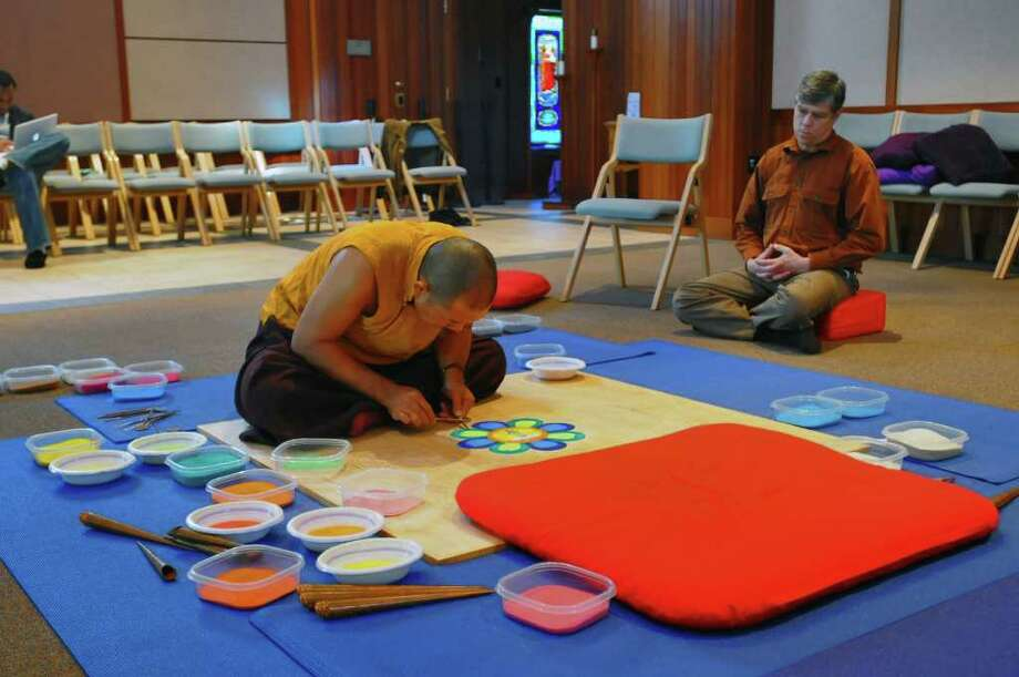 Lama Karma Chopal makes a mandala at the College of Saint Rose Hubbard Interfaith Sanctuary in Albany, NY on Monday October 25, 2010.  Nelson Kent of Albany assists him at right. The mandala will be completed Friday.( Philip Kamrass / Times Union ) Photo: Philip Kamrass