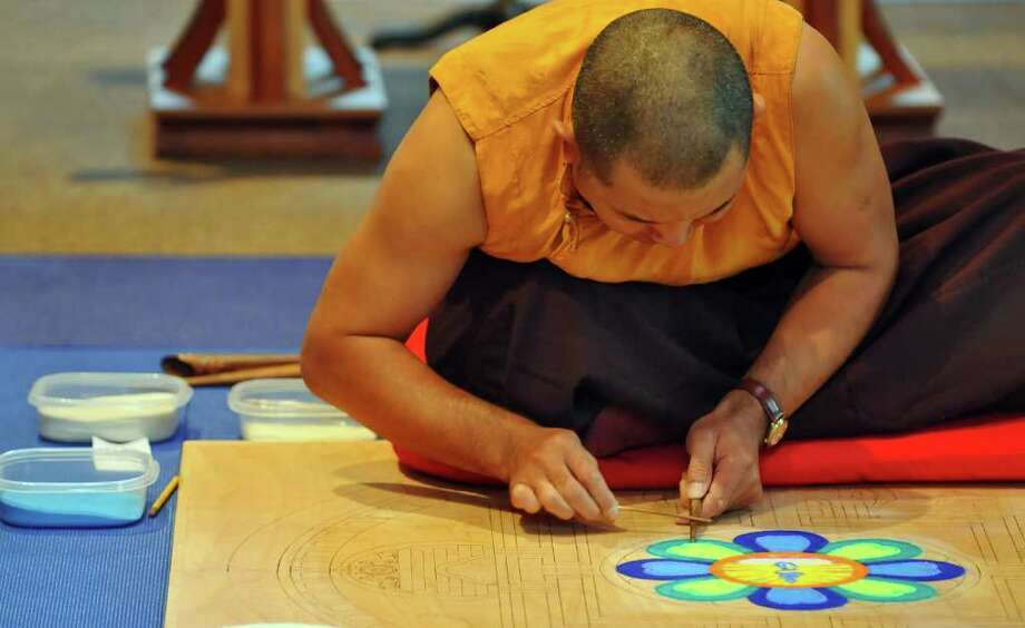 Lama Karma Chopal makes a mandala at the College of Saint Rose Hubbard Interfaith Sanctuary in Albany, NY on Monday October 25, 2010. The mandala will be completed Friday.( Philip Kamrass / Times Union ) Photo: Philip Kamrass