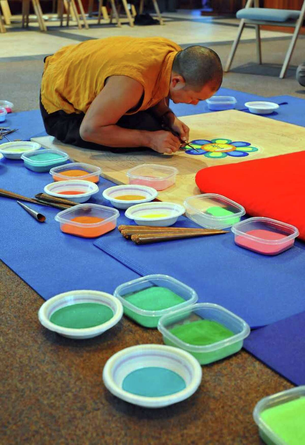 Lama Karma Chopal makes a mandala at the College of Saint Rose Hubbard Interfaith Sanctuary in Albany, NY on Monday October 25, 2010. The mandala will be completed Friday.( Philip Kamrass / Times Union )