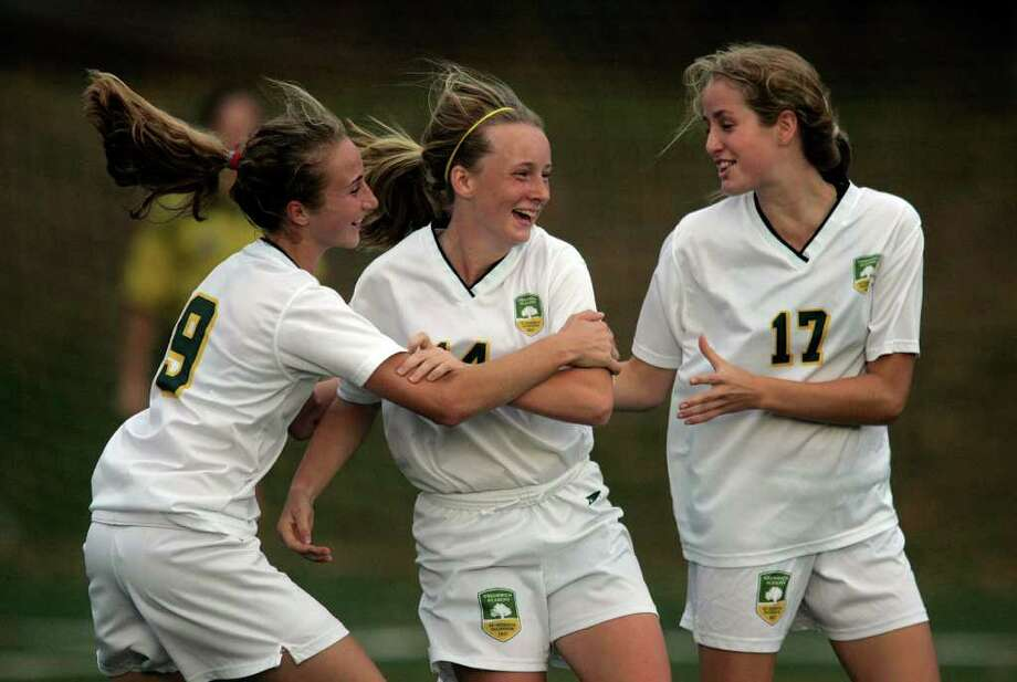 Greenwich Academy player Rachel Oates is congradulated by teammates Hannah Withiam and Victoria Hannover following Oates first half goal. GA won the game in  dominating fashion over the Stamford school.  © J. Gregory Raymond      © J. Gregory Raymond Photo: J. Gregory Raymond / © J. Gregory Raymond for The Advocate