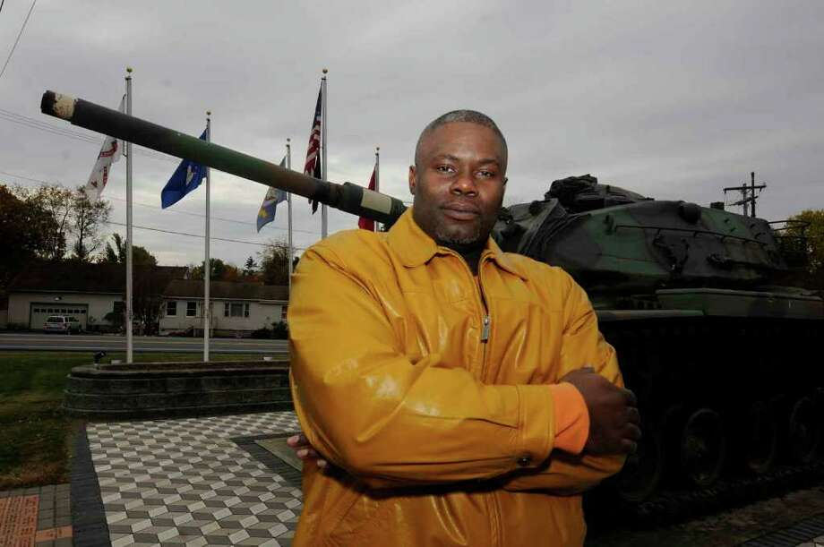 Staff Sgt. Michael Ross at the tank outside the American Legion Mohawk Post in Halfmoon . Ross is one of three fired employees of the National Guard who are fighting the charges in a hearing this week.  (Michael P. Farrell / Times Union) Photo: Michael P. Farrell