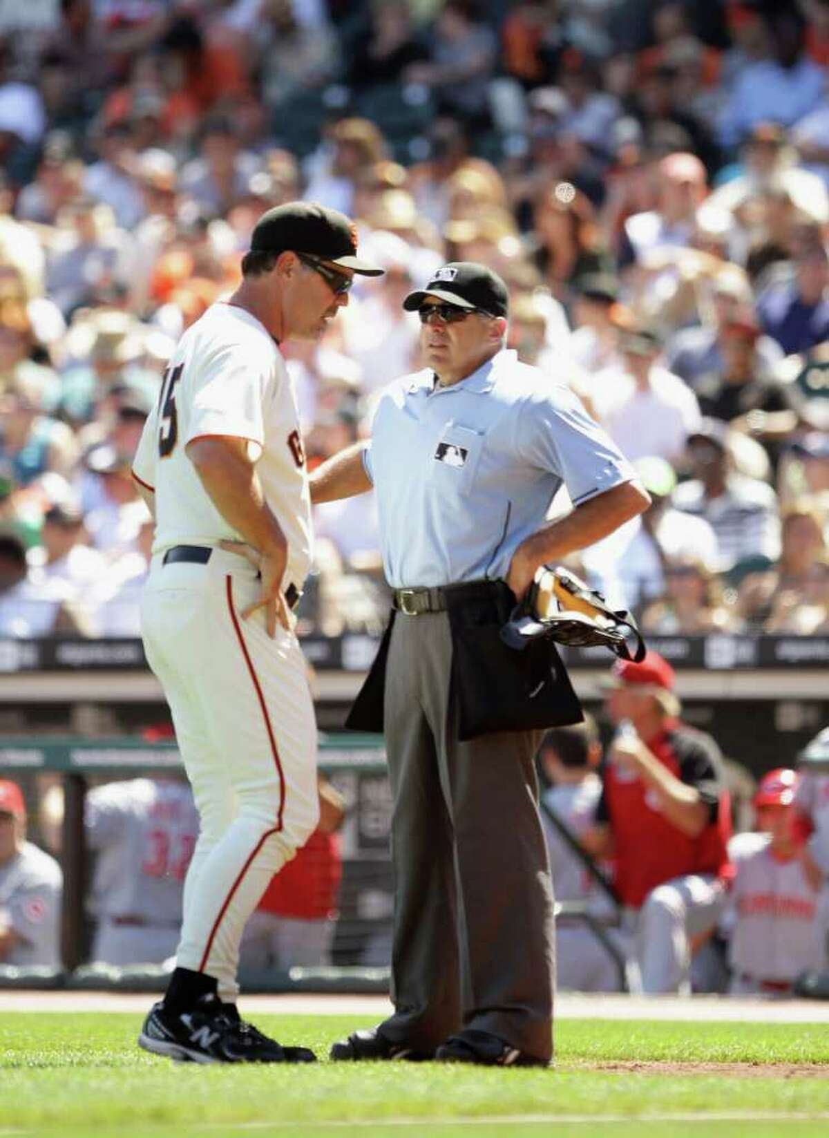 SAN FRANCISCO - AUGUST 25: Manager Bruce Bochy of the San Francisco Giants argues a call with umpire John Hirschbeck after Brandon Phillips #4 of the Cincinnati Reds was hit by a pitch in the fifth inning at AT&T Park on August 25, 2010 in San Francisco, California. (Photo by Ezra Shaw/Getty Images) *** Local Caption *** John Hirschbeck;Bruce Bochy