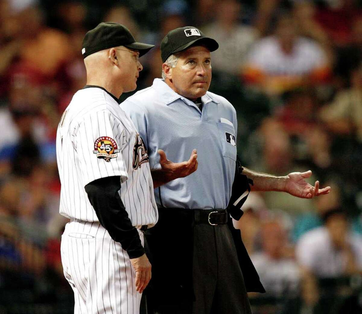 HOUSTON - AUGUST 30: Houston Astros manager Brad Mills (L) argues with home plate umpire John Hirschbeck as to whether Tommy Manzella fouled the ball on the third strike against the St. Louis Cardinals on August 30, 2010 in Houston, Texas. The Astros beat the Cardinals 3-0. (Photo by Bob Levey/Getty Images) *** Local Caption *** Brad Mills;John Hirschbeck