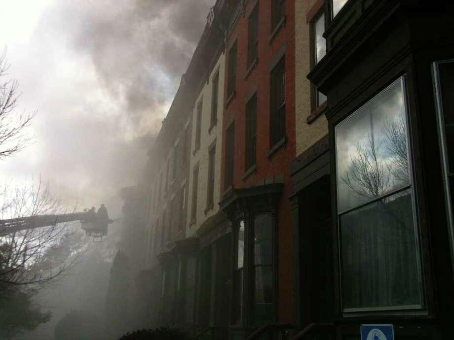 Firefighters battle a blaze in Troy on Tuesday, Oct. 26, 2010. (Paul Buckowski / Times Union)