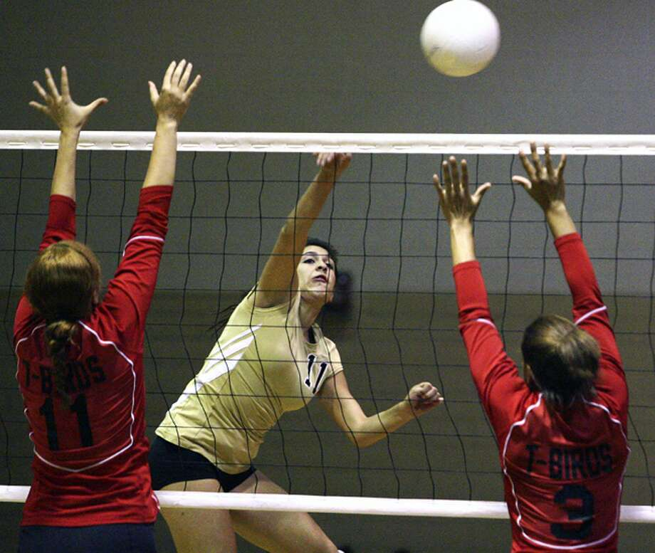 Edison's Vicky Myers attempts to spike over the Wagner defense of Keshia Hiers (left) and Kira Chester.