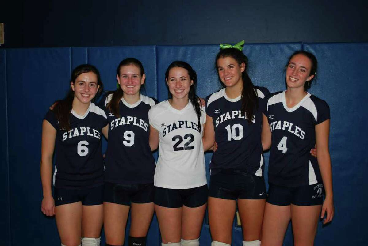 The Staples volleyball team honored its seniors, from left, Kristen Weiler, Melissa Sweeney, tri-captains Dana Rappaport, Alex Masiello and Lucy Stanley on Friday in a 3-2 win over New Canaan on Senior Day.