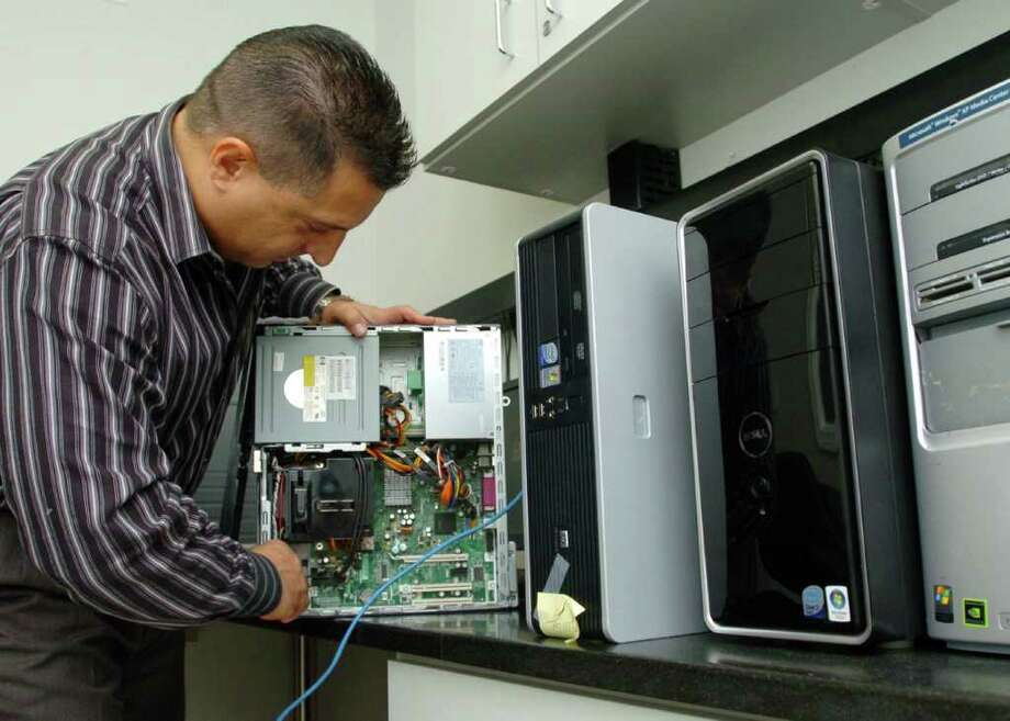 Joe Garzi, of Southridge Technology Group, LLC, works on a computer at his Brookfield office Oct. 26, 2010. Photo: Chris Ware / The News-Times