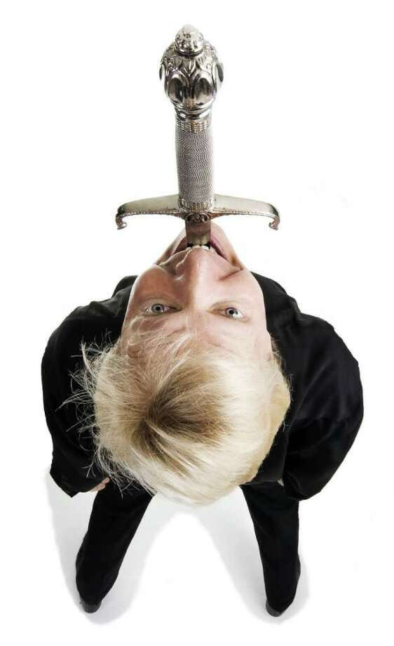 Sword swallower extraordinaire Dan Meyer will appear at the Bruce Museum on Nov. 14. Meyer will offer a talk exploring the techniques and anatomy of the practice of sword swallowing. Photo: Contributed Photo / Greenwich Citizen