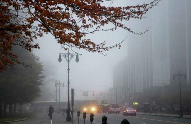 Fog obscures the tops of buildings in downtown Albany on Tuesday morning, Oct. 26, 2010.  (Paul Buckowski / Times Union) Photo: Paul Buckowski