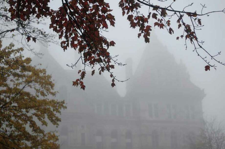 The Capitol is shrouded in fog on Tuesday morning, Oct. 26, 2010.  (Paul Buckowski / Times Union) Photo: Paul Buckowski