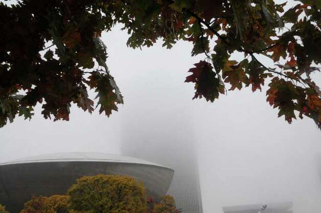 The top floors of the Corning Tower is lost in the fog on Tuesday morning, Oct. 26, 2010.  (Paul Buckowski / Times Union) Photo: Paul Buckowski