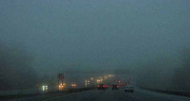 Early-morning commuters deal with fog on their drive in on Interstate 90 on Tuesday morning, Oct. 26, 2010.  (Paul Buckowski / Times Union) Photo: Paul Buckowski