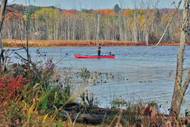 A man tries some late-season fishing from a canoe at Round Lake Tuesday afternoon October 26, 2010.    (John Carl D'Annibale / Times Union) Photo: John Carl D'Annibale