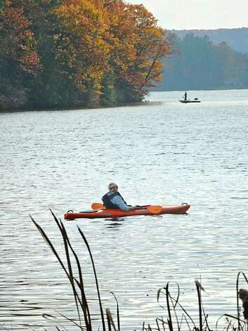 A kayaker and a fisherman enjoy the warm day on Cossayuna Lake in Cossayuna, NY on October 26, 2010.  (Lori Van Buren / Times Union) Photo: Lori Van Buren